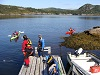 Kayaks on floating dock and in water
